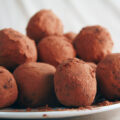 A small white plate piled high with sugar-free chocolate chip truffles.
