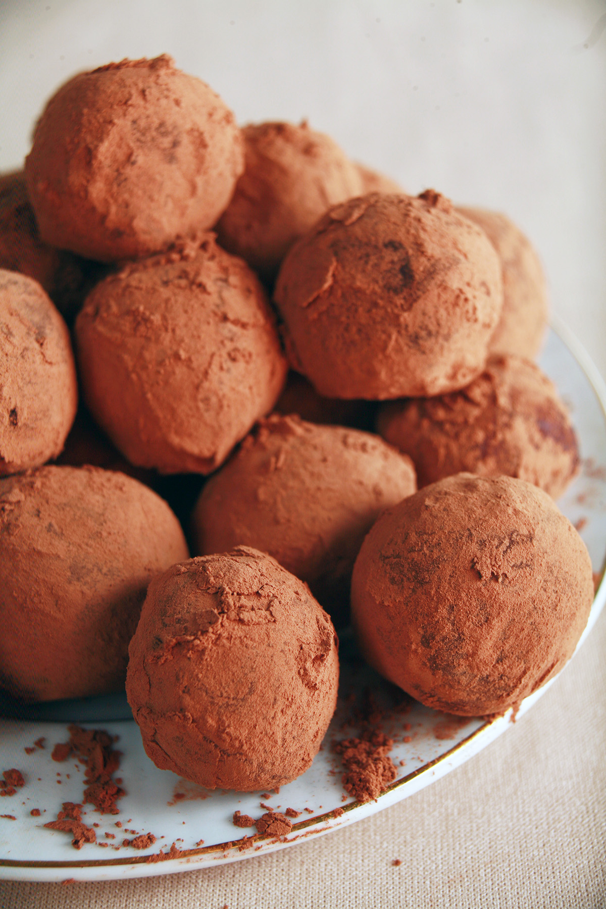 A small white plate piled high with sugar-free chocolate truffles.
